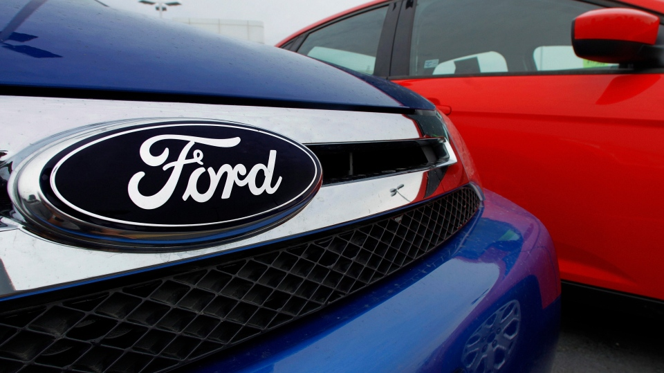 The Ford logo is seen on cars for sale at a Ford dealership, July 1, 2012. (AP / Seth Perlman)