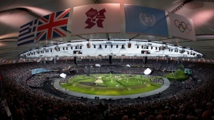 Perfromers gather during the Opening Ceremony at the 2012 Summer Olympics, in London, Friday, July 27, 2012. (AP / Lee Jin-man)