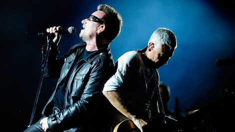 Bono, left, and Adam Clayton of Irish band U2 perform during their first concert of the new European tour after Bono underwent back surgery following an injury during training, in Turin, Italy, Friday, Aug. 6, 2010. (AP / Massimo Pinca)