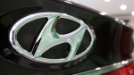 In this July 26, 2012 file photo, the logo of Hyundai Motor Co. is seen on its car at the company's showroom in Seoul, South Korea. (AP Photo/Ahn Young-joon, File)