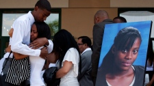 People mourn next to a photo of shooting victim Shyanne Charles