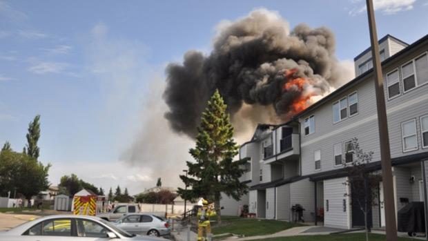 Fire at Haywood Court Condominium in Grande Prairie on Friday. Photo: William Vavrek.