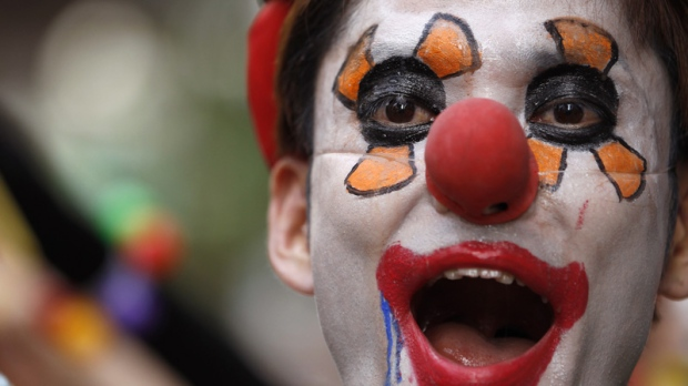 An anti-nuclear protester wearing a clown outfit in Tokyo on July 29, 2012.