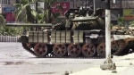 This image made from amateur video released by the Shaam News Network and accessed Sunday, July 29, 2012, shows a Syrian military tank in Daraa, Syria. (Shaam News Network via AP video)