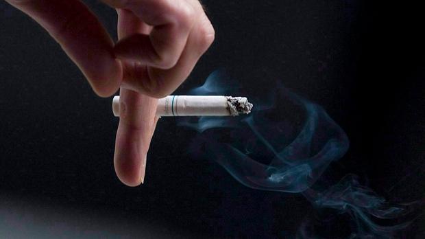 A person smokes a cigarette. (Pawel Dwulit / THE CANADIAN PRESS)