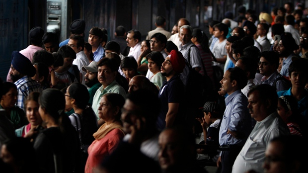 Stranded passengers at New Delhi railway station are pictured during a widespread power outage in India on Monday, July 30, 2012. (AP Photo/Rajesh Kumar Singh)