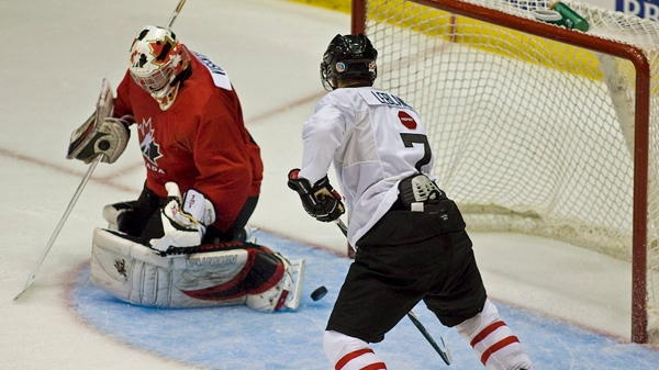 Louis Leblanc scores on Mark Visentin during an inter-squad game at the national junior hockey team development camp in St. John's, N.L. on Friday, August 6, 2010.THE CANADIAN PRESS /Andrew Vaughan