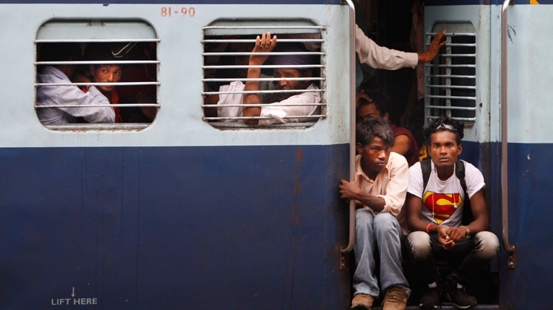 Passengers sit in a train and wait for power to be restored at a railway station, in New Delhi, India, Monday, July 30, 2012. (AP / Rajesh Kumar Singh)