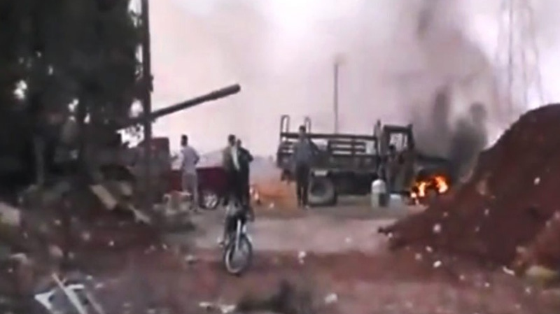 This image made from amateur video purports to show Free Syrian Army soldiers just outside Aleppo, Syria, Monday, July 30, 2012. (AP Photo/Ugarit News via AP video)