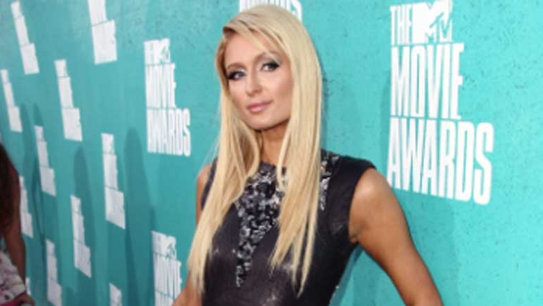Paris Hilton arrived at the MTV Movie Awards in Los Angeles on Sunday, June 3, 2012. (Invision / Matt Sayles)