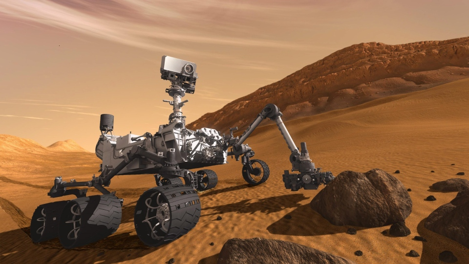 The Mars Science Laboratory Curiosity rover examines a rock on Mars in this 2011 artist's rendering. (NASA/JPL-Caltech)