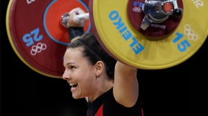 Christine Girard of Canada competes during the women's 63-kg weightlifting competition at the 2012 Summer Olympics, Tuesday, July 31, 2012, in London. (AP Photo/Mike Groll)