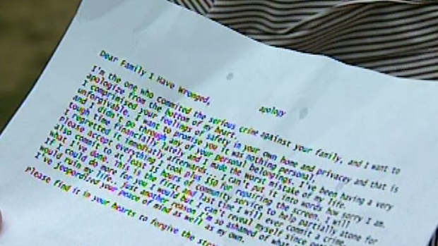 An apology note given to a family whose home was hit by a thief is seen in Guelph, Ont. on Tuesday, July 31, 2012.