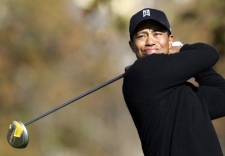 Tiger Woods tees off on the fifth hole during the Target World Challenge golf tournament at Sherwood Country Club in Thousand Oaks, Calif. on Dec. 14, 2007. (AP / Reed Saxon)