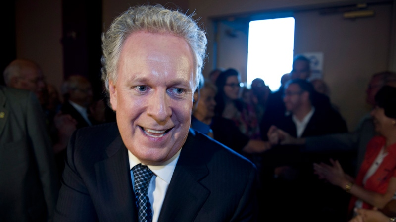 Quebec Premier Jean Charest makes his way through a crowd of supporters as he arrives for his nomination meeting in Montreal on Tuesday, July 31, 2012. (Paul Chiasson / THE CANADIAN PRESS)