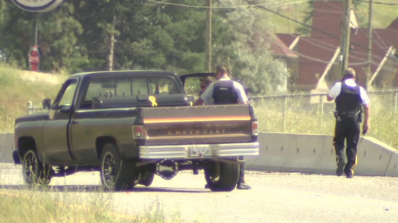 Mounties examine a suspect vehicle following a tense police chase in West Kelowna, B.C. Tuesday afternoon. July 31, 2012. (CTV)