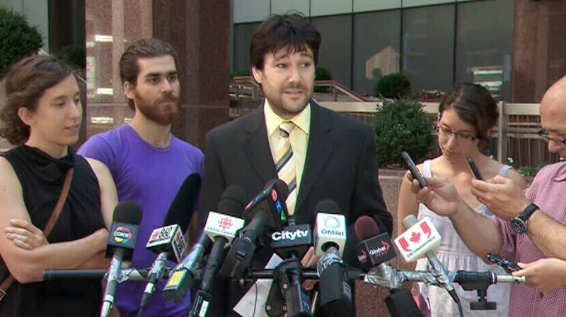 Lawyer Davin Charney speaks with reporters about a $1.4 million lawsuit on Wednesday, Aug. 1, 2012.