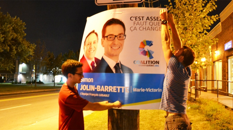 Political supporters got off to an early start last night, postering for their candidates into the late hours. (Photo: Cosmo Santamaria)