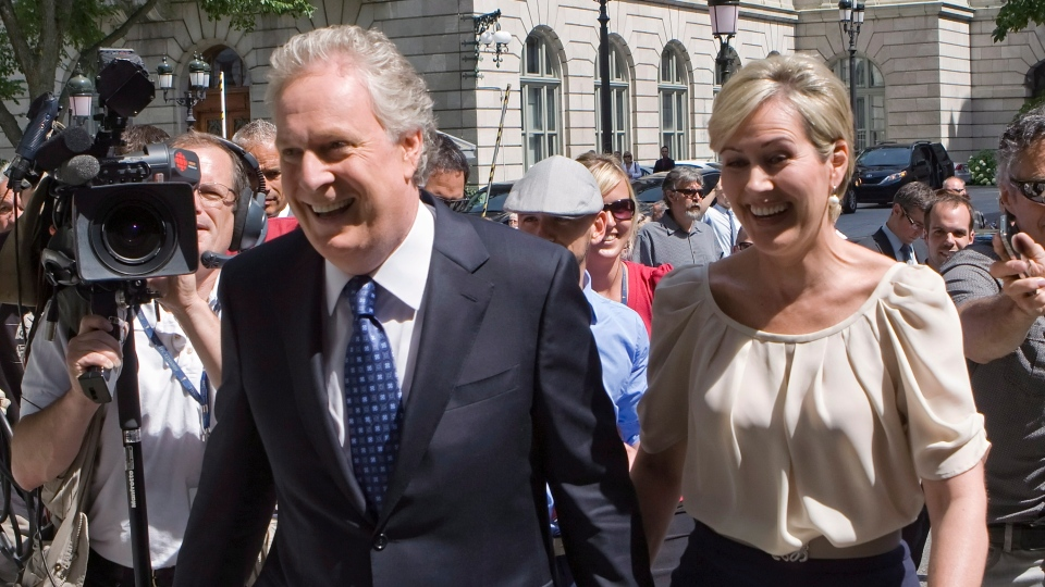 Quebec Premier Jean Charest and his wife Michelle Dionne right, arrive to meet with the Quebec lieutenant-governor to call a provincial election in Quebec City, Wednesday Aug. 1, 2012. (Clement Allard / THE CANADIAN PRESS)