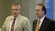 Former Justice Minister Marc Bellemarre, right, walks with his lawyer Jean-Francois Bertrand during a recess at the courthouse Tuesday, August 10, 2010 in Quebec City. (THE CANADIAN PRESS/Jacques Boissinot)