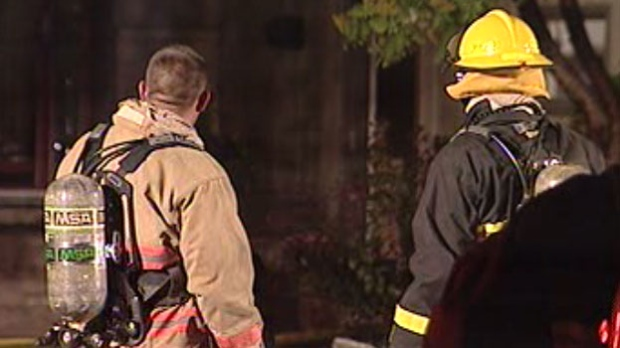Fire crews look on after a house fire is extinguished on Cameo Crescent Wednesday night.