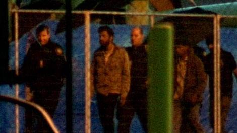 Officers escort Sri Lankan asylum-seekers from the MV Ocean Lady in 2009. (CTV)