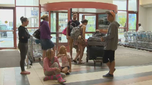 Bride Tammy Baldwin and her wedding party of eight were due in Cox Harbour, NL today for a rehearsal dinner, but became stranded at the Halifax Stanfield International Airport due to flight delays.