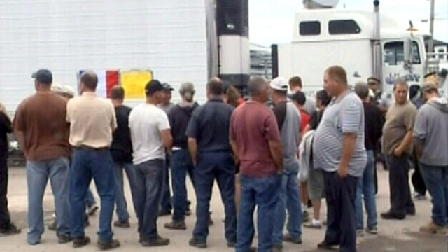 Lobster fishermen in New Brunswick block a truck from unloading 36,000 pounds of live Maine lobster, Thursday, Aug. 2, 2012.