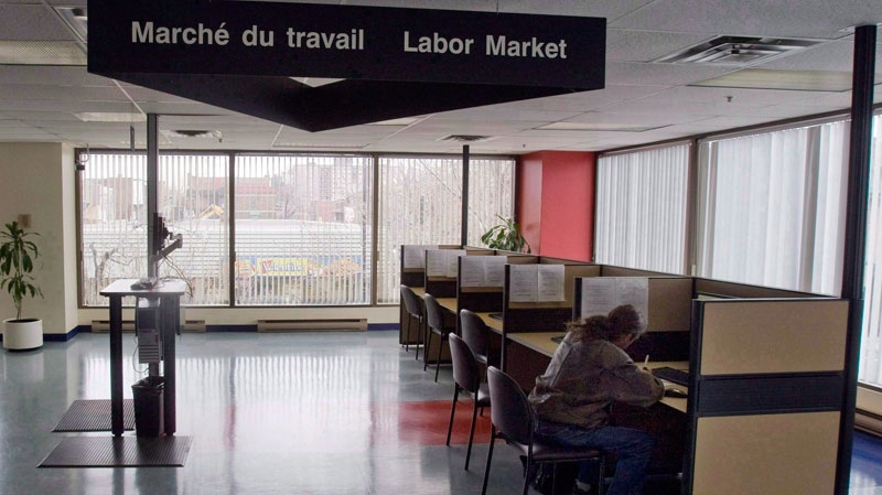 A man looks through jobs at a Resource Canada offices in Montreal, Thursday, April 9, 2009. (Ryan Remiorz / THE CANADIAN PRESS)
