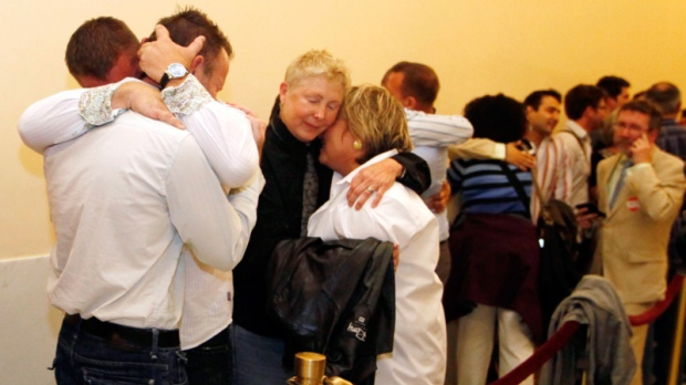 Same-sex couples waiting in line to be married from left Sarah Shuchter and April Williamson, of Pacifica, Calif., Robert Huddleston and Chris Holler of San Francisco, react to the news that they may not marry for at least another week Thursday, Aug. 12, 2010, in San Francisco. (AP / Eric Risberg)