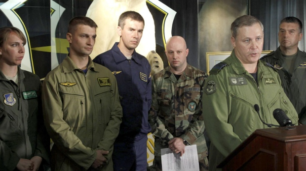 "Canadian Forces Col. Todd Balfe, second from right, deputy commander of the Alaska NORAD Region, talks to reporters, Wednesday, Aug. 11, 2010 at Elmendorf Air Force Base in Anchorage, Alaska, about the conclusion of exercise ""Vigilant Eagle."" (AP / Ted S. Warren)"