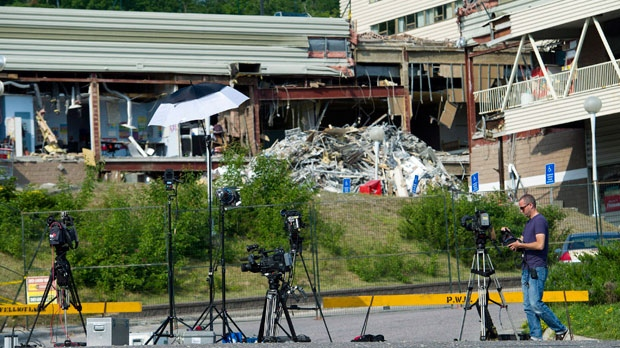 Media equipment lines the entrance to the Algo Centre Mall in Elliot Lake, Ont., on June 28, 2012. (Nathan Denette / THE CANADIAN PRESS)