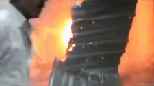 Unverified Image made from amateur video of fire in the Yarmouk refugee camp in Damascus, Syria.