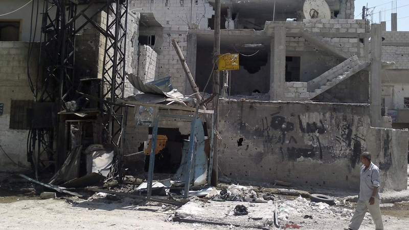This image purports to show destruction as a result of shelling by Syrian government forces in Daraa, Syria on Thursday, Aug. 2, 2012. (AP /Shaam News Network, SNN)