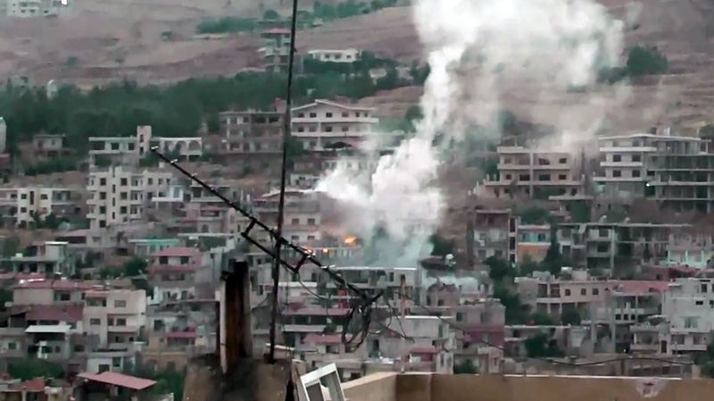 This image purports to show shelling in Zabadani, near Damascus, Syria on Saturday, Aug. 4, 2012. (AP /Shaam News Network, SNN)