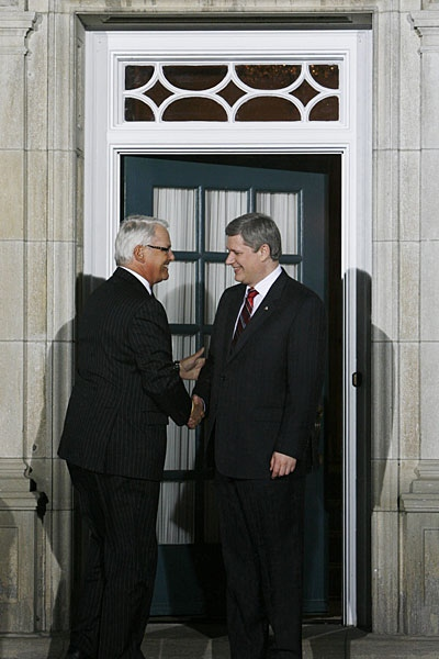 British Columbia Premier Gordon Campbell (left) is greeted by Prime Minister Stephen Harper before the provincial and territoral first ministers meeting in Ottawa on Friday, Jan. 11, 2008. (Sean Kilpatrick / THE CANADIAN PRESS)