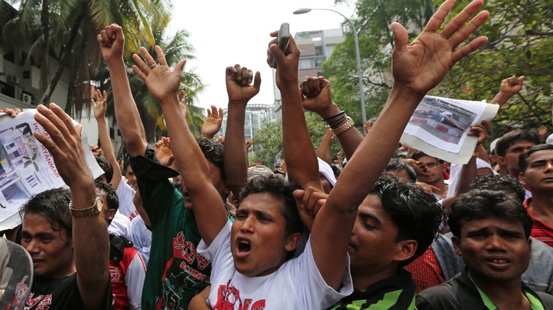 Rohingya Muslims living in Malaysia shout slogans during a rally calling for an end to the violence against ethnic Rohingya in Rakhine state of Myanmar, in Kuala Lumpur, Malaysia on Friday, Aug. 3, 2012. (AP Photo)