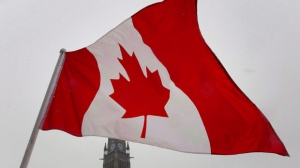 The Canadian flag is shown blowing in the wind in this undated photo.