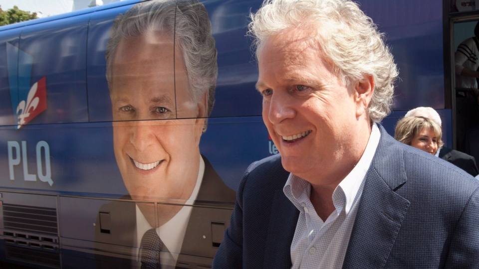 Quebec Liberal Party leader Jean Charest walks from his campaign bus to attend a local meeting while campaigning in Grand-Mere, Que., on Saturday, August 4, 2012. (Jacques Boissinot / THE CANADIAN PRESS)