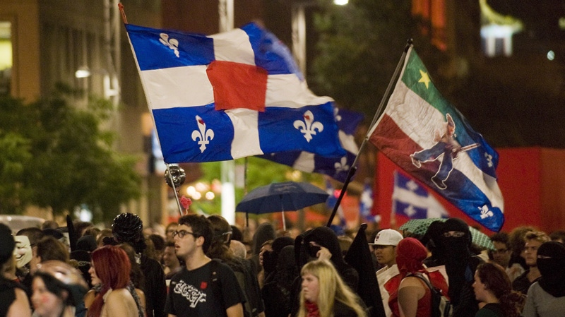 Protesters opposing Quebec student tuition fee hikes demonstrate in Montreal, Wednesday, August 1, 2012, on day one of the provincial election. (THE CANADIAN PRESS/Graham Hughes)