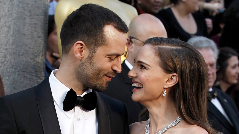 Benjamin Millepied, left, and Natalie Portman arrive before the 84th Academy Awards on Sunday, Feb. 26, 2012, in the Hollywood section of Los Angeles. (AP Photo/Matt Sayles)