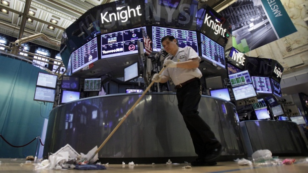 Billy Ying sweeps the New York Stock Exchange after the close of trading on Aug. 3, 2012.