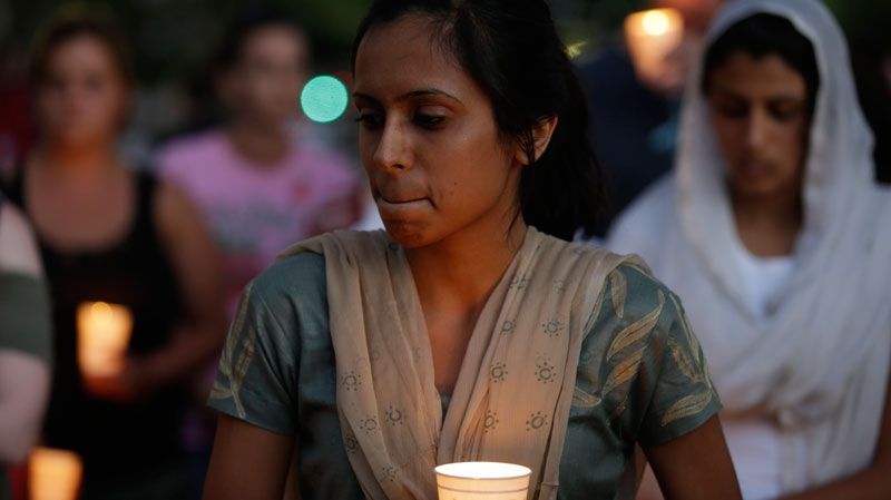 Mourners take part in a candle light vigil for the victims of the Sikh Temple of Wisconsin shooting, in Milwaukee, Sunday, Aug 5, 2012. (AP / Jeffrey Phelps)
