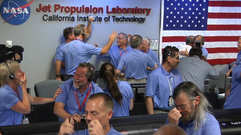Mars Science Laboratory (MSL) team members react after the Curiosity rover successfully landed on Mars and as first images start coming in to the Jet Propulsion Laboratory, Sunday, Aug. 5, 2012 in Pasadena, Calif. (NASA / JPL-Caltech)