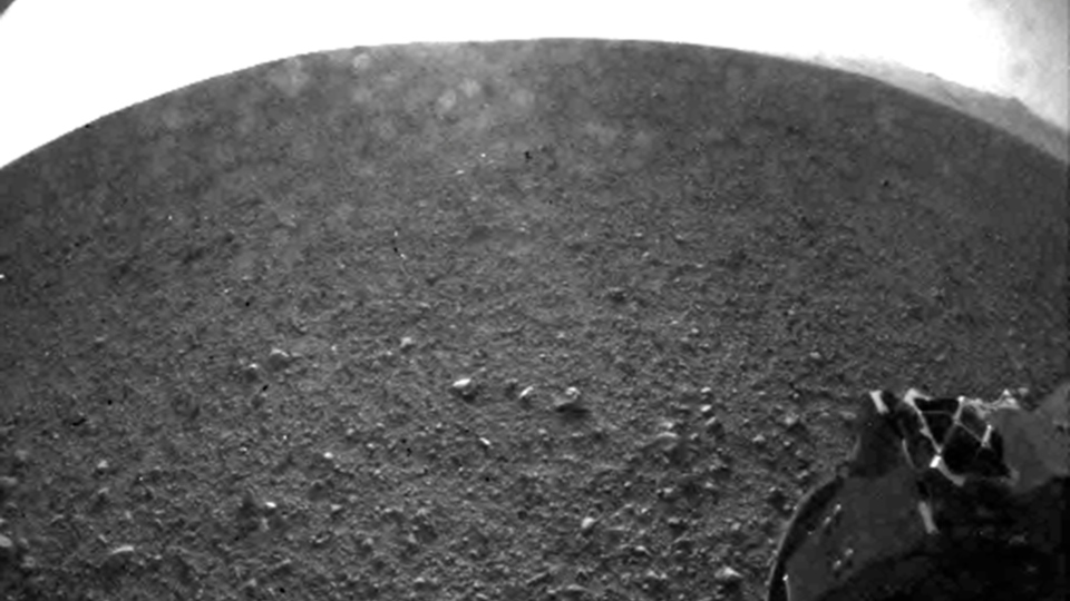 This is one of the first images taken by NASA's Curiosity rover, which landed on Mars. It was taken with a 'fisheye' wide-angle lens on the left 'eye' of a stereo pair of Hazard-Avoidance cameras on the left-rear side of the rover. (NASA / JPL-Caltech)