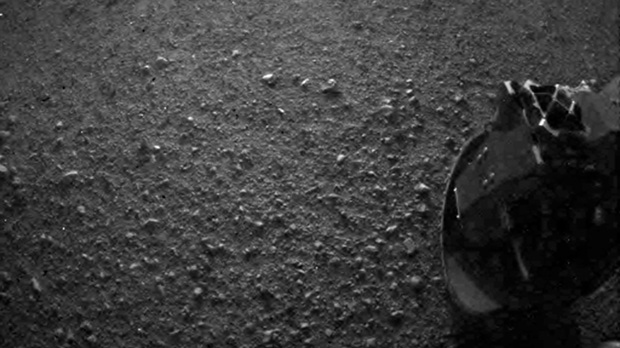 This photo released by NASA's JPL is one of the first images taken by NASA's Curiosity rover, which landed on Mars the evening of Aug. 5, 2012 (PDT). (AP Photo/NASA/JPL-Caltech)