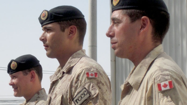 Three Canadian soldiers were awarded commendations Friday, Aug. 13, 2010 for their role in stopping an Aug. 3 attack on the main NATO military base in Kandahar. Sgt. Marc-Andre Rousseau, left to right, and Cpl. Joseph Henry, both members of the Combat Engineers in Kandahar from Valcartier, Que., as well as Sapper Kirk Farrell, of Petawawa, Ont., were outside the secure perimeter of the base when a group of insurgents attacked. (Dene Moore / THE CANADIAN PRESS)