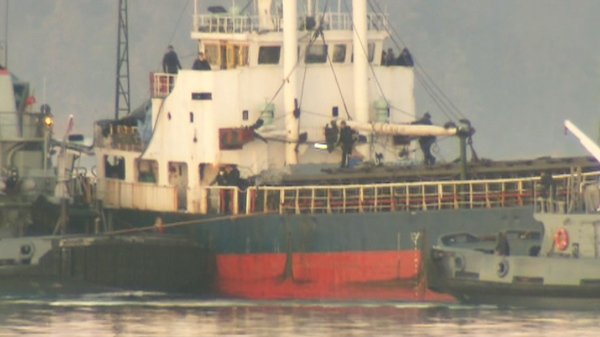 After three months at sea, the MV Sun Sea cargo ship carrying nearly 500 Tamil migrants is being towed into a Vancouver Island harbour on Friday, Aug. 13, 2010.