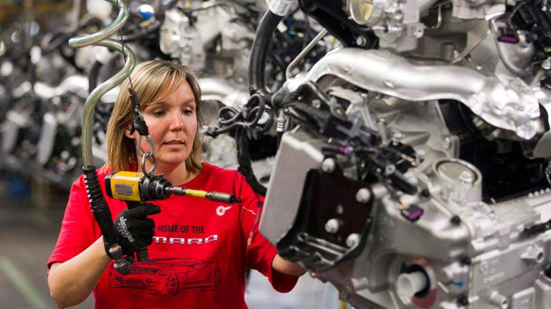 Engine Specialist Jennifer Souch works at the GM factory in Oshawa, Ontario on Friday, June 10, 2011. (Frank Gunn / THE CANADIAN PRESS)
