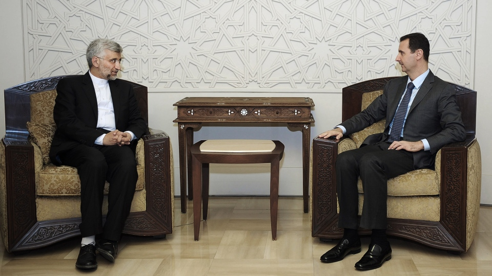 Iran's Supreme National Security Council, Saeed Jalili, right, meets with Syrian President Bashar Assad in Damascus, Syria, Tuesday, Aug. 7, 2012. (AP / SANA)